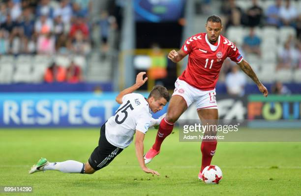 MarcOliver Kempf of Germany attempts to tackle Kenneth Zohore of Denmark during the UEFA European Under21 Championship Group C match between Germany...