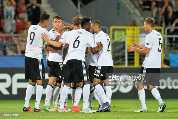 MarcOliver Kempf of Germany celebrates scoring his sides second goal with his Germany team mates during the UEFA European Under21 Championship Group...