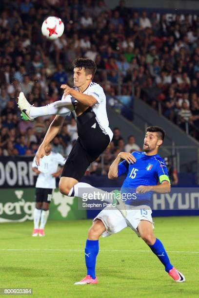 MarcOliver Kempf of Germany controls the ball in mid air while under pressure from Marco Benassi of Italy during the 2017 UEFA European Under21...