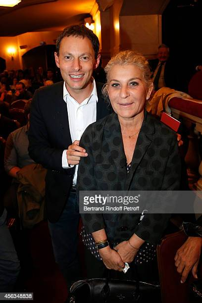 MarcOlivier Fogiel and guest attend the tribute to Gisele Casadesus celebrating her 100th anniversary at Theatre Edouard VII on September 29 2014 in...