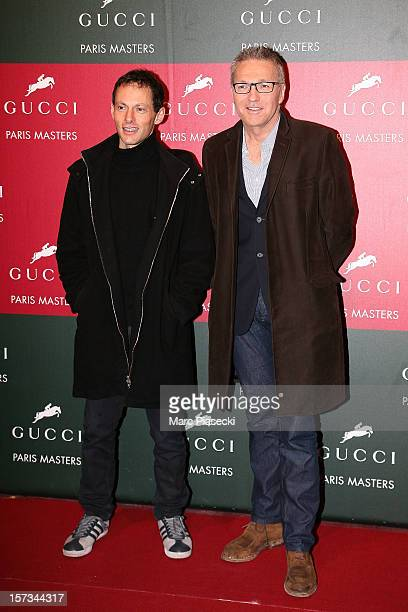MarcOlivier Fogiel and Laurent Ruquier attend the 'Gucci Paris Masters 2012' at Paris Nord Villepinte on December 2 2012 in Paris France