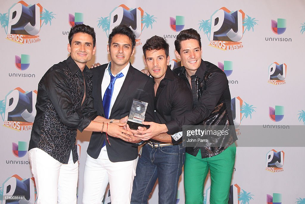 Marconi pose in the press room during the Premio Juventud 2013 at Bank United Center on July 18, 2013 in Miami, Florida.