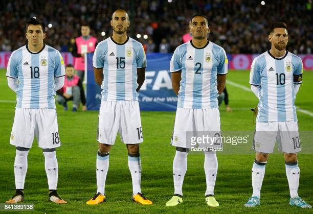 Marcos Acuña Guido Pizarro Gabriel Mercado and Lionel Messi of Argentina line up for the National Anthem prior to a match between Uruguay and...
