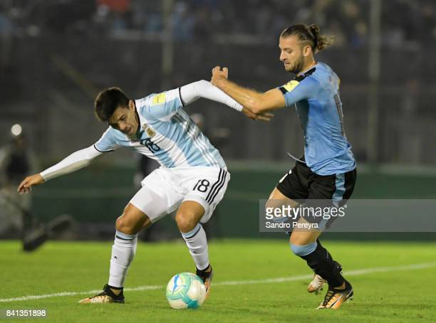 Marcos Acuña of Argentina and Gaston Silva of Uruguay fight for the ball during a match between Uruguay and Argentina as part of FIFA 2018 World Cup...