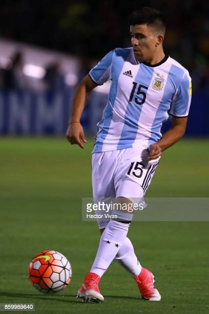 Marcos Acuña of Argentina drives the ball during a match between Ecuador and Argentina as part of FIFA 2018 World Cup Qualifiers at Olimpico...
