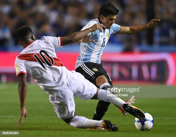 Marcos Acuña of Argentina fights for ball with Jefferson Farfan of Peru during a match between Argentina and Peru as part of FIFA 2018 World Cup...