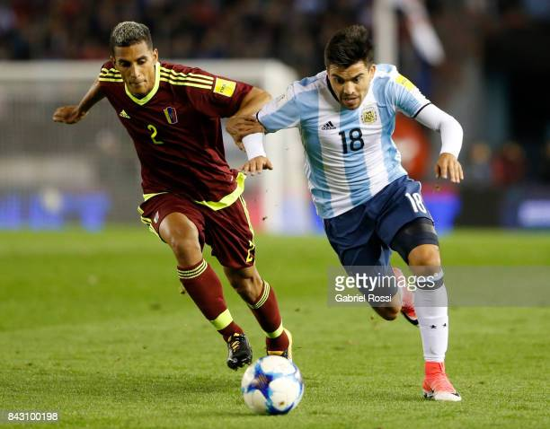 Marcos Acuña of Argentina fights for the ball with Victor Garcia of Venezuela during a match between Argentina and Venezuela as part of FIFA 2018...