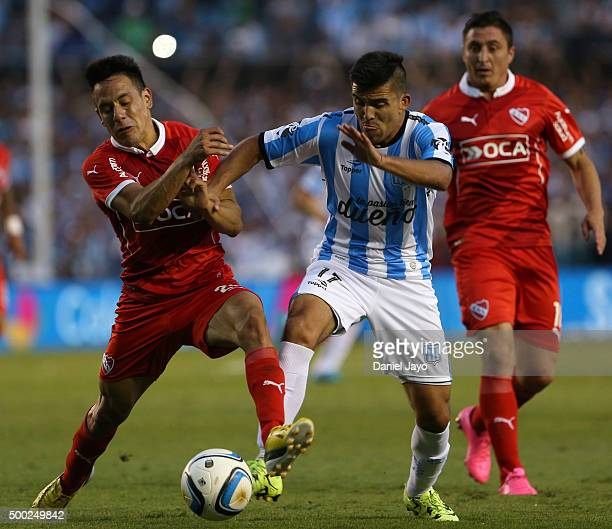 Marcos Acuña of Racing Club and Gustavo Toledo of Independiente fight for the ball during a second leg match between Independiente and Racing Club as...
