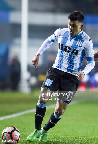 Marcos Acuña of Racing Club drives the ball during the first leg match between Racing Club and Deportivo Independiente Medellin as part of second...