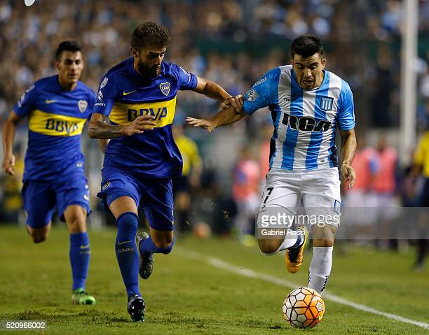 Marcos Acuña of Racing Club fights for the ball with Gino Peruzzi of Boca Juniors during a match between Racing and Boca Juniors as part of Copa...