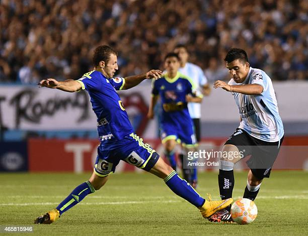 Marcos Acuña of Racing Club fights for the ball with Horacio Calcaterra of Sporting Cristal during a match between Racing Club and Sporting Cristal...