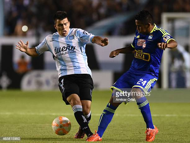 Marcos Acuña of Racing Club fights for the ball with Josue Estrada of Sporting Cristal during a match between Racing Club and Sporting Cristal as...