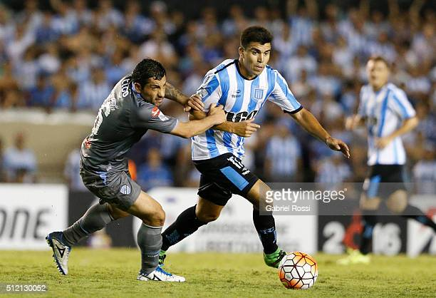 Marcos Acuña of Racing Club fights for the ball with Walter Flores of Bolivar during a group stage match between Racing Club and Bolivar as part of...