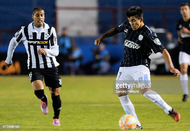 Marcos Acuña of Racing Club kicks the ball as Alex Silva of Montevideo Wanderers runs towards him during a first leg match between Montevideo...