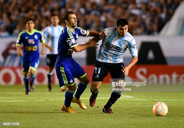 Marcos Acuña of Racing Club struggles for the ball with Horacio Calcaterra of Sporting Cristal during a match between Racing Club and Sporting...