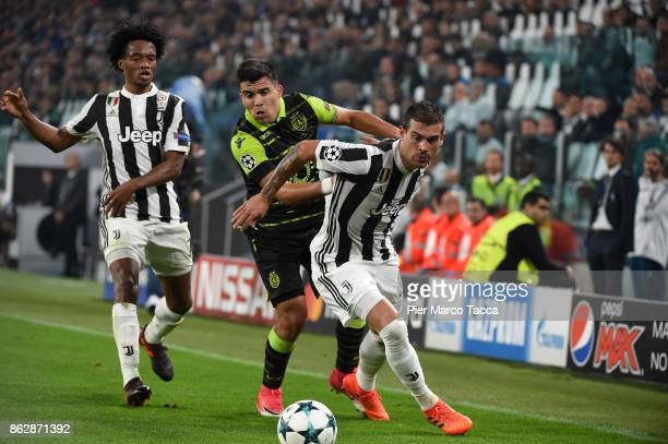 Marcos Acuna of Sporting CP competes for the ball with Stefano Sturaro of Juventus during the UEFA Champions League group D match between Juventus...