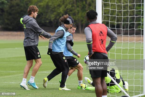 Marcos Alonso David Luiz and Cesar Azpilicueta of Chelsea during a training session at Chelsea Training Ground on April 28 2017 in Cobham England