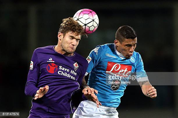 Marcos Alonso of ACF Fiorentina battles for the ball with Allan of SSC Napoli during the Serie A match between ACF Fiorentina and SSC Napoli at...
