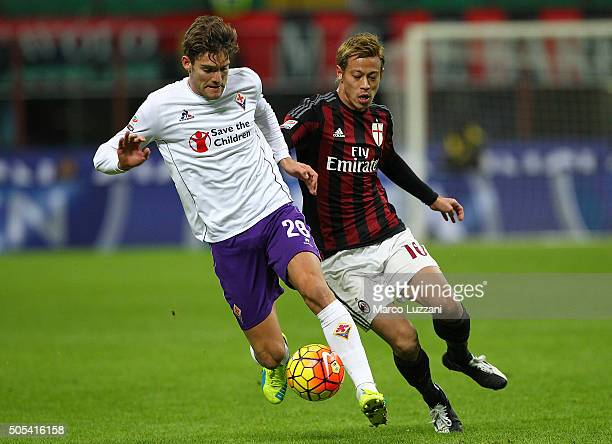 Marcos Alonso of ACF Fiorentina competes for the ball with Keisuke Honda of AC Milan during the Serie A match between AC Milan and ACF Fiorentina at...