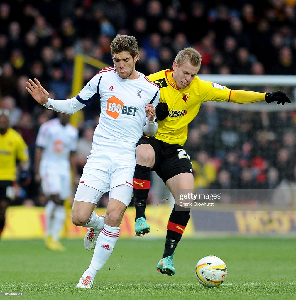 <a gi-track='captionPersonalityLinkClicked' href=/galleries/search?phrase=Marcos+Alonso&family=editorial&specificpeople=3648323 ng-click='$event.stopPropagation()'>Marcos Alonso</a> of Bolton clashes with Matej Vydra of Watford during the npower Championship match between Watford and Bolton Wanderers at Vicarage Road on February 02, 2013 in Watford England.