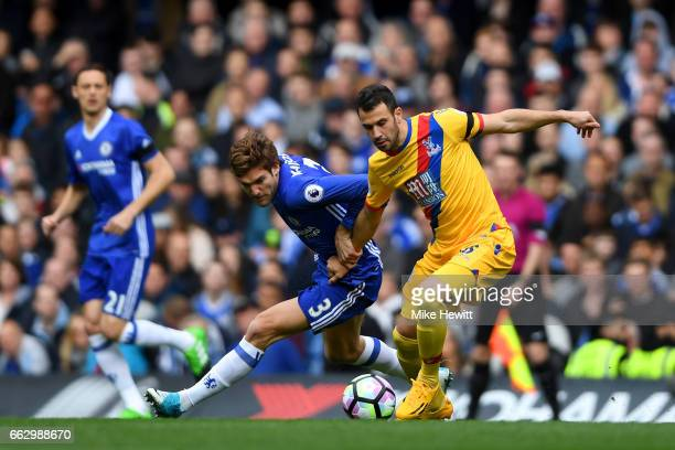 Marcos Alonso of Chelsea and Luka Milivojevic of Crystal Palace battle for possession during the Premier League match between Chelsea and Crystal...
