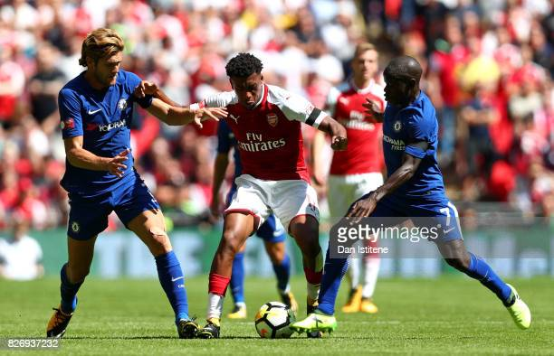 Marcos Alonso of Chelsea and N'Golo Kante of Chelsea attempt to tackle Alex Iwobi of Arsenal during the The FA Community Shield final between Chelsea...