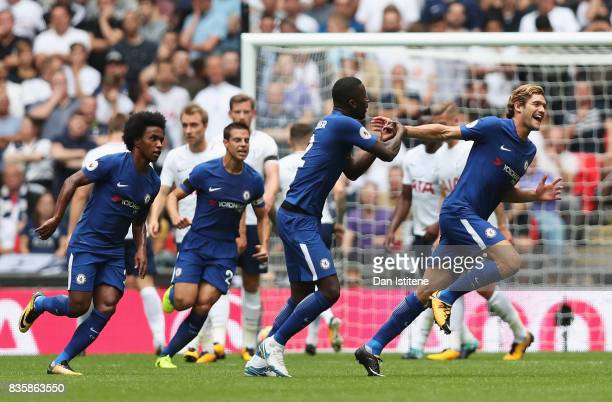 Marcos Alonso of Chelsea celebrates scoring his sides first goal with his Chelsea team mates during the Premier League match between Tottenham...