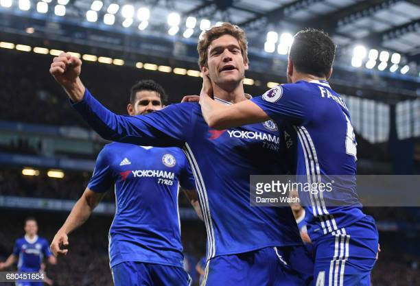 Marcos Alonso of Chelsea celebrates with team mates after scoring his sides second goal during the Premier League match between Chelsea and...