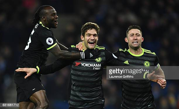 Marcos Alonso of Chelsea celebrates with teammates Victor Moses and Gary Cahill after scoring his team's second goal during the Premier League match...
