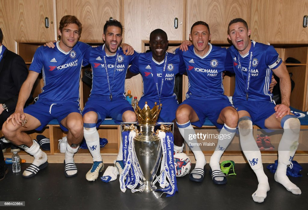 Marcos Alonso of Chelsea, Cesc Fabregas of Chelsea, N'Golo Kante of Chelsea, Nemanja Matic of Chelsea, Gary Cahill of Chelsea pose with the Premier League Trophy after the Premier League match between Chelsea and Sunderland at Stamford Bridge on May 21, 2017 in London, England.