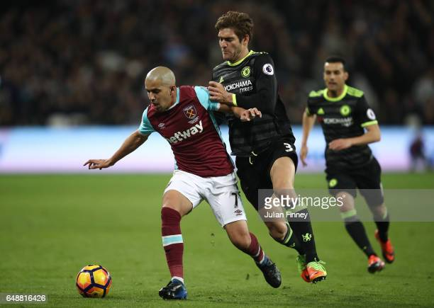 Marcos Alonso of Chelsea closes down Sofiane Feghouli of West Ham United during the Premier League match between West Ham United and Chelsea at...