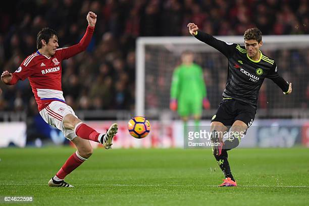 Marcos Alonso of Chelsea crosses the ball as Marten de Roon of Middlesbrough attempts to block during the Premier League match between Middlesbrough...