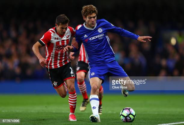 Marcos Alonso of Chelsea holds off Cedric Soares of Southampton during the Premier League match between Chelsea and Southampton at Stamford Bridge on...
