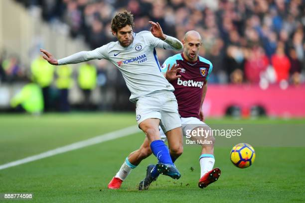 Marcos Alonso of Chelsea is challenged by Pablo Zabaleta of West Ham United during the Premier League match between West Ham United and Chelsea at...