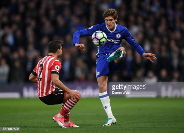 Marcos Alonso of Chelsea is faced by Cedric Soares of Southampton during the Premier League match between Chelsea and Southampton at Stamford Bridge...