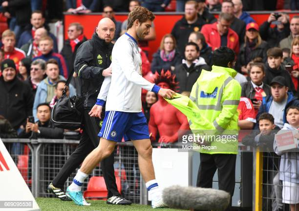 Marcos Alonso of Chelsea leaves the pitch following the warm up prior to the Premier League match between Manchester United and Chelsea at Old...