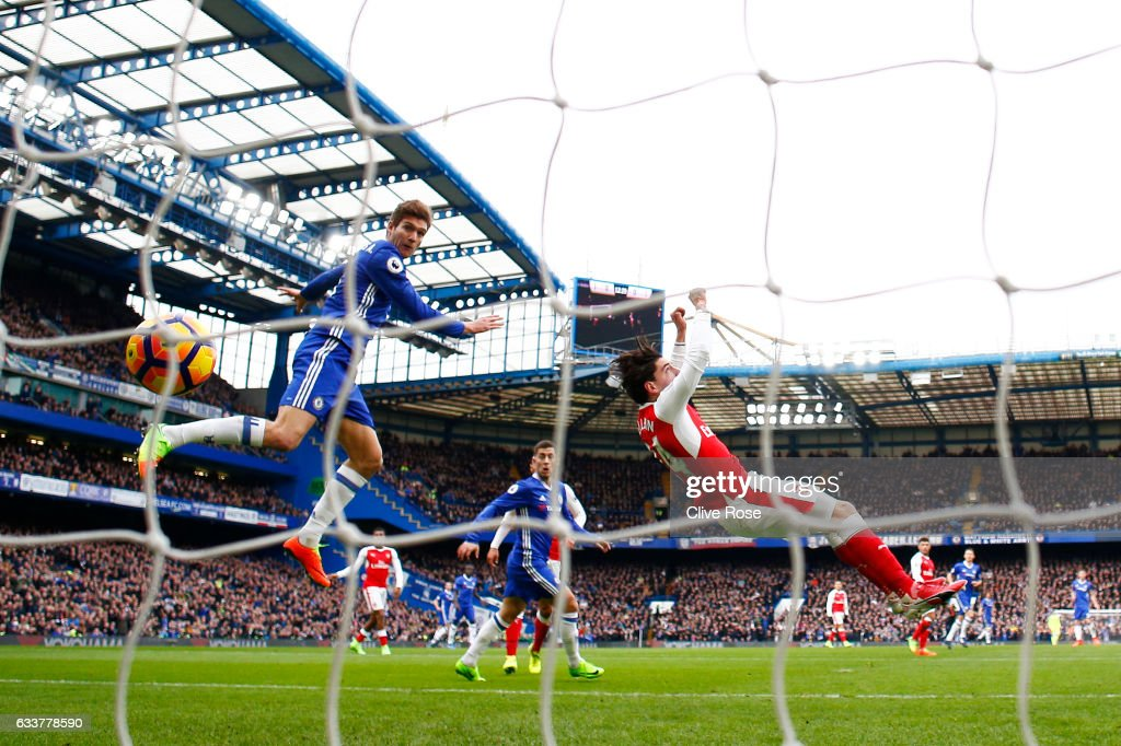 Marcos Alonso of Chelsea scores the opening goal past Petr Cech of Arsenal during the Premier League match between Chelsea and Arsenal at Stamford Bridge on February 4, 2017 in London, England.