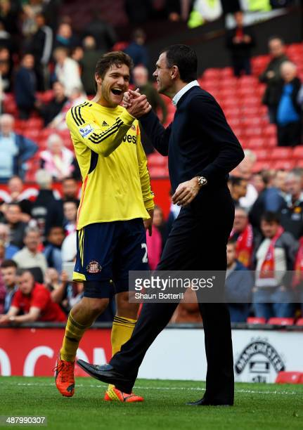 Marcos Alonso of Sunderland and Gustavo Poyet the Sunderland manager celebrate their eam's 10 victory during the Barclays Premier League match...