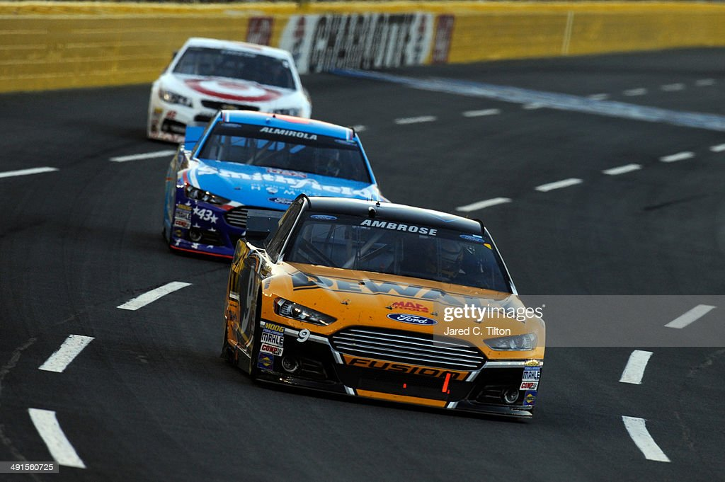<a gi-track='captionPersonalityLinkClicked' href=/galleries/search?phrase=Marcos+Ambrose&family=editorial&specificpeople=179434 ng-click='$event.stopPropagation()'>Marcos Ambrose</a>, driver of the #9 DeWalt Ford, leads <a gi-track='captionPersonalityLinkClicked' href=/galleries/search?phrase=Aric+Almirola&family=editorial&specificpeople=574878 ng-click='$event.stopPropagation()'>Aric Almirola</a>, driver of the #43 Smithfield Ford, and <a gi-track='captionPersonalityLinkClicked' href=/galleries/search?phrase=Kyle+Larson+-+Race+Car+Driver&family=editorial&specificpeople=2115989 ng-click='$event.stopPropagation()'>Kyle Larson</a>, driver of the #42 Target Chevrolet, during the NASCAR Sprint Cup Series Sprint Showdown at Charlotte Motor Speedway on May 16, 2014 in Charlotte, North Carolina..