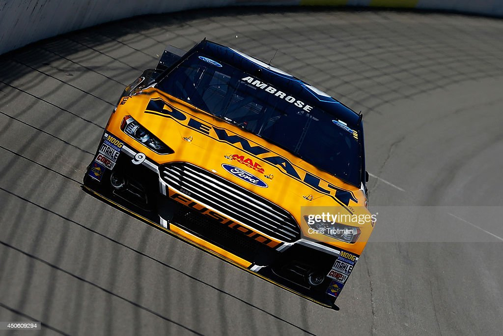 Marcos Ambrose, driver of the #9 DeWalt Ford, practices for the NASCAR Sprint Cup Series Quicken Loans 400 at Michigan International Speedway on June 14, 2014 in Brooklyn, Michigan.