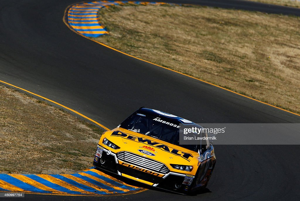 <a gi-track='captionPersonalityLinkClicked' href=/galleries/search?phrase=Marcos+Ambrose&family=editorial&specificpeople=179434 ng-click='$event.stopPropagation()'>Marcos Ambrose</a>, driver of the #9 DeWalt Ford, qualifies for the NASCAR Sprint Cup Series Toyota/Save Mart 350 at Sonoma Raceway on June 21, 2014 in Sonoma, California.