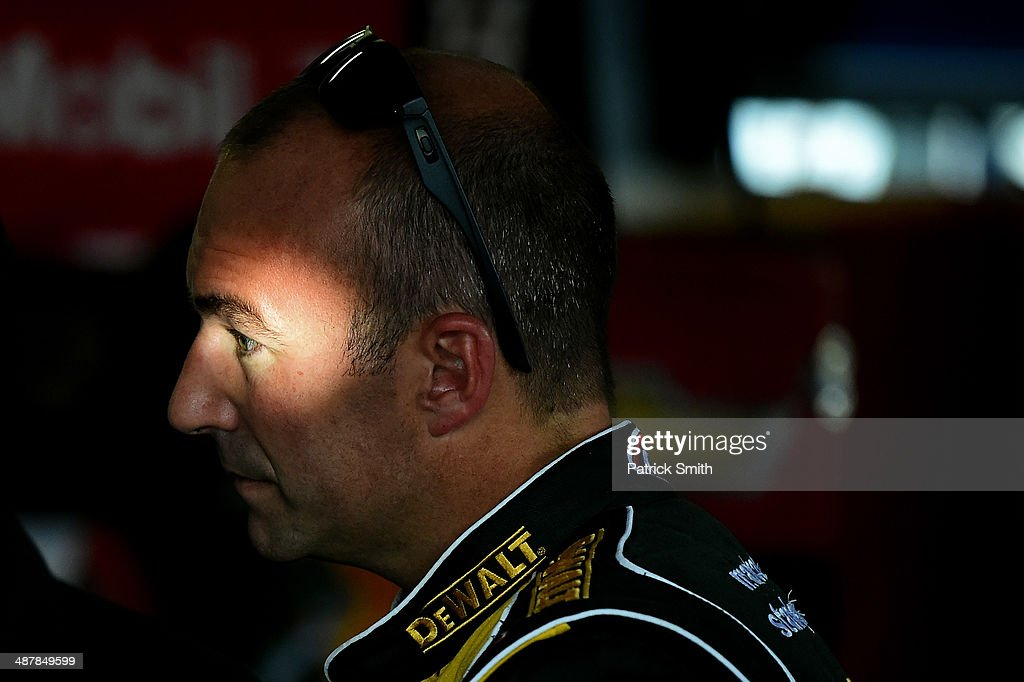 Marcos Ambrose, driver of the #9 DeWalt Ford, stands in the garage during practice for the NASCAR Sprint Cup Series Aaron's 499 at Talladega Superspeedway on May 2, 2014 in Talladega, Alabama.