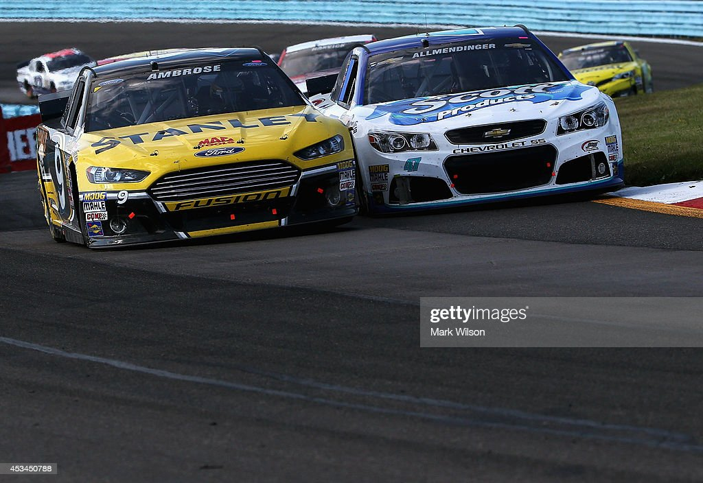 Marcos Ambrose, driver of the #9 Stanley Ford, and AJ Allmendinger, driver of the #47 Scott Products Chevrolet, race the NASCAR Sprint Cup Series Cheez-It 355 at Watkins Glen International on August 10, 2014 in Watkins Glen, New York.
