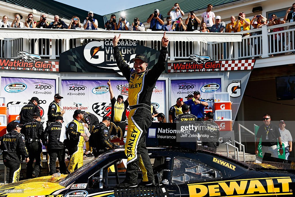 Marcos Ambrose, driver of the #09 Stanley Ford, celebrates in Victory Lane after winning the NASCAR Nationwide Zippo 200 at Watkins Glen International on August 9, 2014 in Watkins Glen, New York.