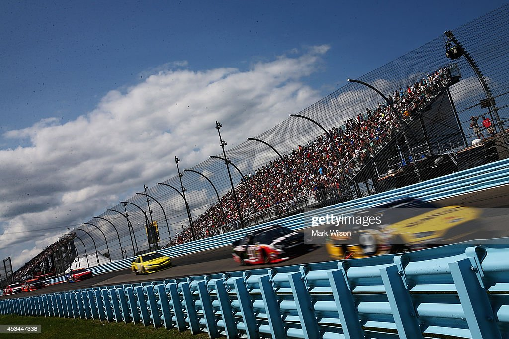 Marcos Ambrose, driver of the #9 Stanley Ford, leads a pack of cars during the NASCAR Sprint Cup Series Cheez-It 355 at Watkins Glen International on August 10, 2014 in Watkins Glen, New York.