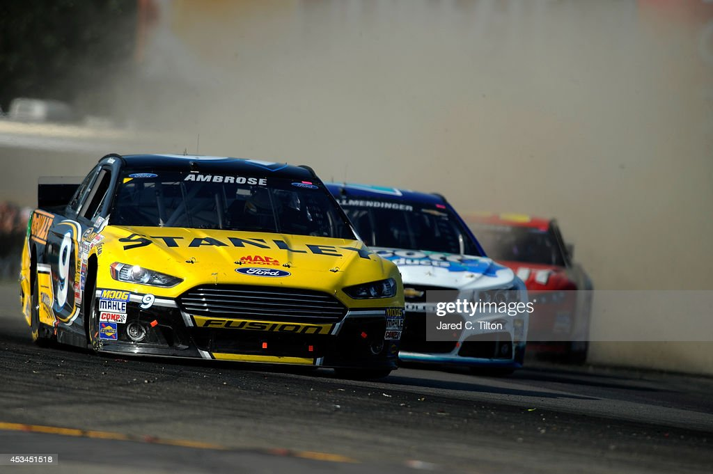 Marcos Ambrose, driver of the #9 Stanley Ford, leads AJ Allmendinger, driver of the #47 Scott Products Chevrolet, during the NASCAR Sprint Cup Series Cheez-It 355 at Watkins Glen International on August 10, 2014 in Watkins Glen, New York.