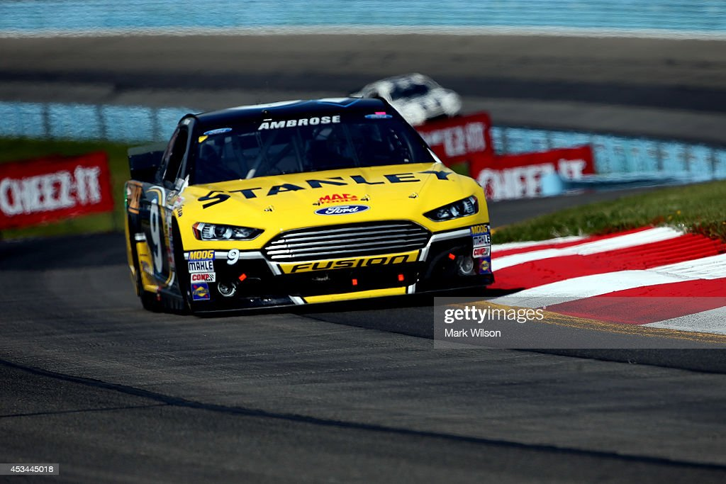 Marcos Ambrose, driver of the #9 Stanley Ford, leads Jimmie Johnson, driver of the #48 Lowe's Chevrolet, during the NASCAR Sprint Cup Series Cheez-It 355 at Watkins Glen International on August 10, 2014 in Watkins Glen, New York.