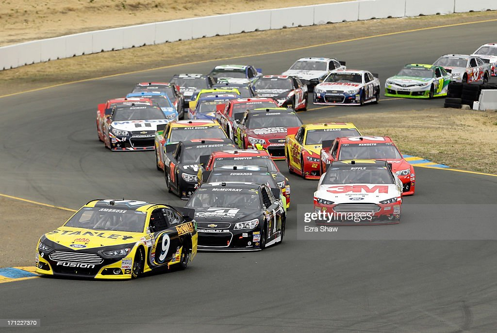 Marcos Ambrose, driver of the #9 Stanley Ford, leads the field during the start of the NASCAR Sprint Cup Series Toyota/Save Mart 350 at Sonoma Raceway on June 23, 2013 in Sonoma, California.