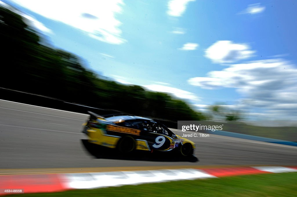 Marcos Ambrose, driver of the #9 Stanley Ford, races the NASCAR Sprint Cup Series Cheez-It 355 at Watkins Glen International on August 10, 2014 in Watkins Glen, New York.