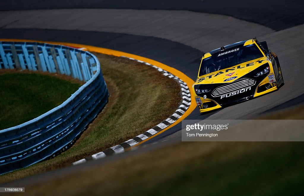 <a gi-track='captionPersonalityLinkClicked' href=/galleries/search?phrase=Marcos+Ambrose&family=editorial&specificpeople=179434 ng-click='$event.stopPropagation()'>Marcos Ambrose</a>, driver of the #9 Stanley/CTC Jumpstart Ford, drives during qualifying for the NASCAR Sprint Cup Series Cheez-It 355 at The Glen at Watkins Glen International on August 10, 2013 in Watkins Glen, New York.